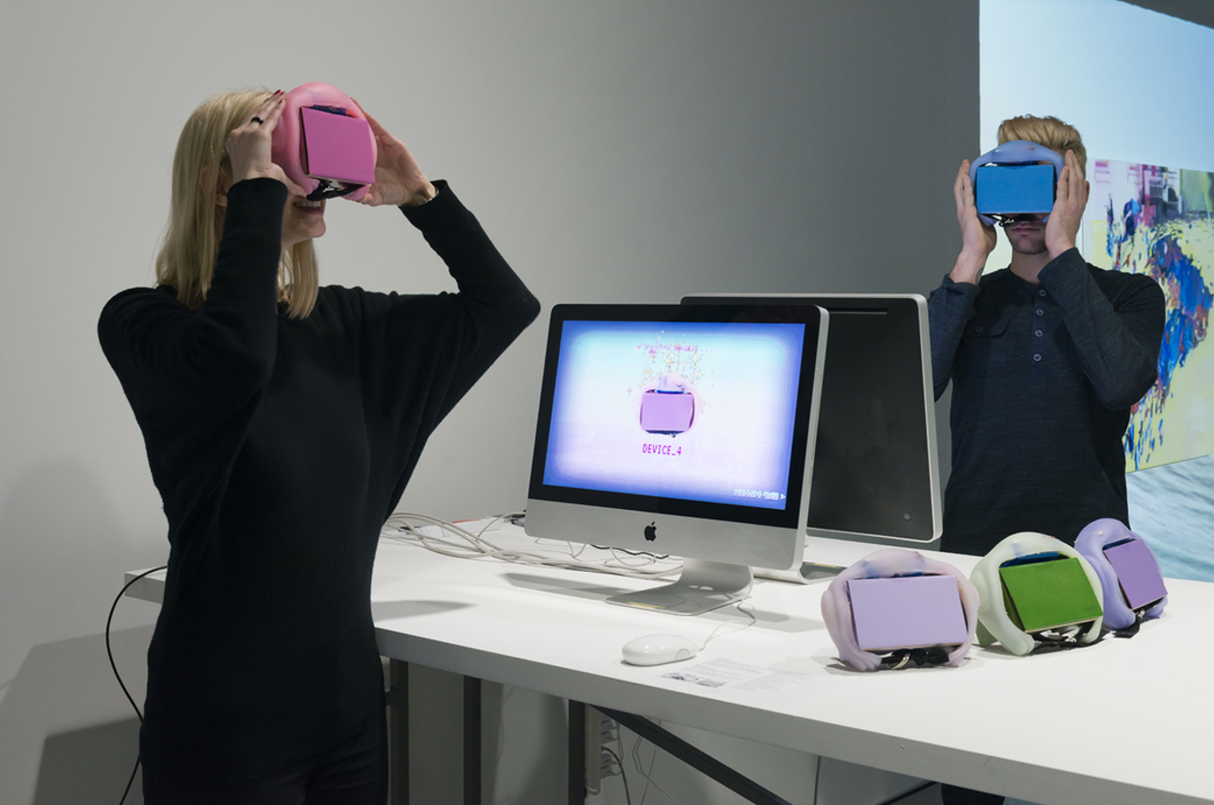 Two people play with VR headsets encased in silicone.